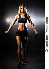 Fit, healthy and sporty woman doing expander exercise - Fit,...