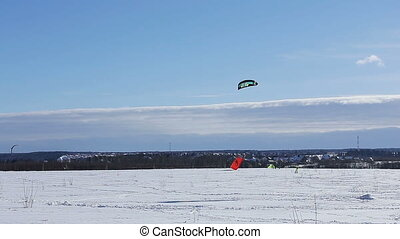 Snowkiting on a snowboard - Winter snowkiting on the winter...
