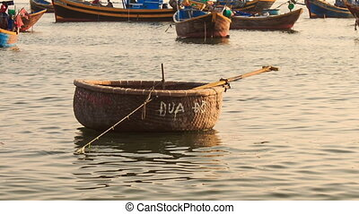Empty Round Vietnamese Fishing Boat Floats on Sea