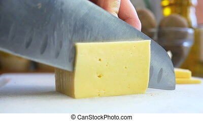 Man cutting piece of cheese