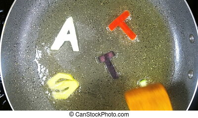 Stir-frying mixed alphabet letters, word Tasty