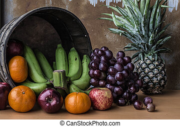 Fresh fruits on a wooden board.