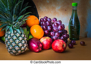 Pineapple and fresh fruits on a table.
