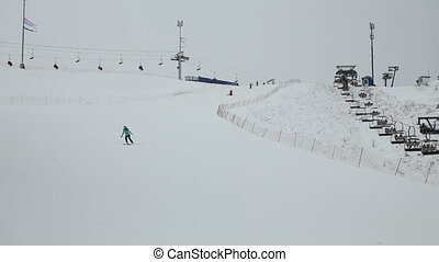 woman skier down the hill.Skiers and snowboarders skiing...