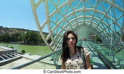 Girl on bridge in park - Girl goes on new beautiful bridge...