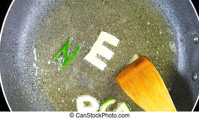 Stir-frying mixed alphabet letters, word Green