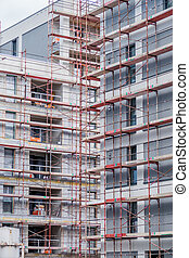new house - scaffolding at a construction site for a new...