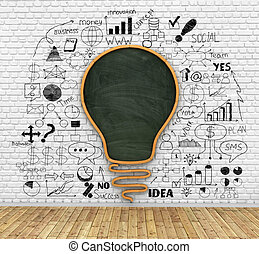 school blackboard in shape of idea lightbulb on the breaks...