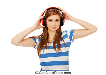 Teenage woman listening to the music