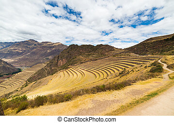 Expansive view of Inca terraces in Pisac, Sacred Valley,...