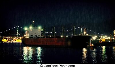 Tanker Ship Passing Bridge At Night - Large tanker sailing...