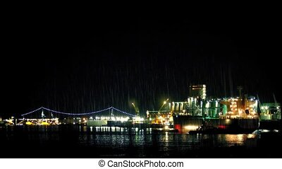 Tanker Docking Near City At Night