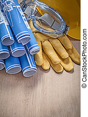 Protective workwear blue rolled engineering drawings on...