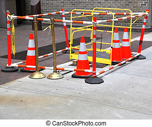 Safety barrier - Bright colorful orange traffic cones...