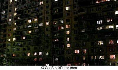 Lights flickering in windows time lapse