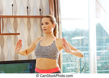 Young woman doing exercise at home