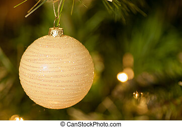 White Bauble on Christmas tree - Closeup image of white...