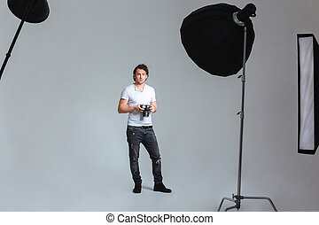 Photographer standing in professional studio - Male...