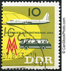 GERMAN DEMOCRATIC REPUBLIC - 1963: shows plane and bus -...