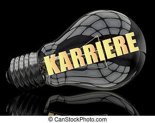 Karriere - german word for career - lightbulb on black...