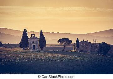 Tuscany landscape at sunrise. Chapel of Madonna di Vitaleta,...