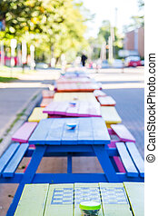 Checkerboard on Green Picnic Table - A line of colorful...
