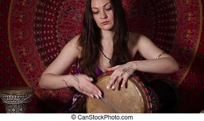 Young Caucasian woman playing the d - Young Caucasian woman...