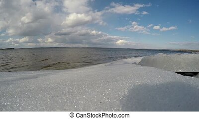 Melting ice on the lake in warmer weather The spring on the...
