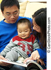 Asian family reading together