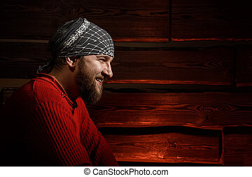 brutal handsome man with beard on red background