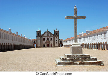 Big cross with church in the background