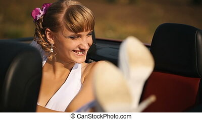 Bride in the back seat of the car - Smiling Bride in the...