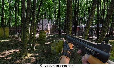 Playing paintball POV - Playing paintball, panoramic POV...
