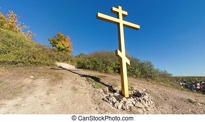 Christian cross on hill, pano shot - Panoramic shot from...