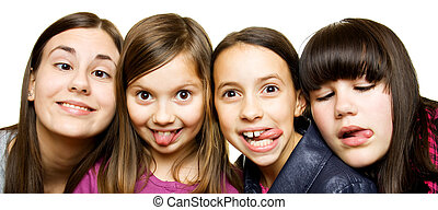 Four young girls making funny faces