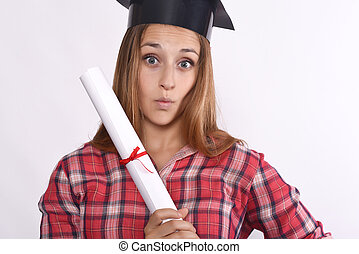 Young girl graduate with cap and diploma.