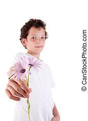 cute boy offering flowers