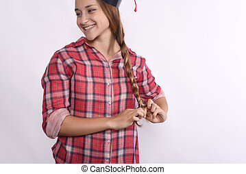 Young girl graduate with cap.