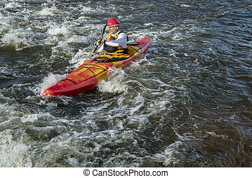 paddling whitewater kayak - senior whitewater kayaker...