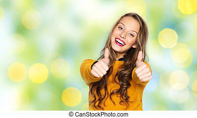 happy young woman or teen girl showing thumbs up - people,...