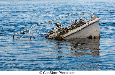 Ship wreck in a river - Rusty boat wreck in a blue river