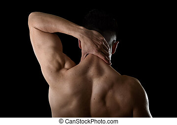 young muscular sport man holding sore neck massaging cervical area suffering body pain