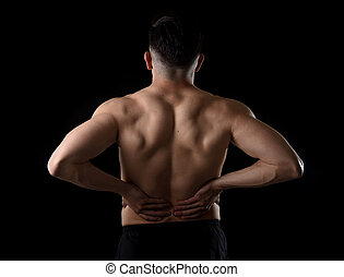 sport man holding sore low back - young muscular body sport...
