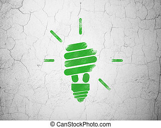Finance concept: Energy Saving Lamp on wall background