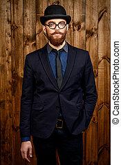 man in bowler hat - Elegant man wearing suit, bowler hat and...