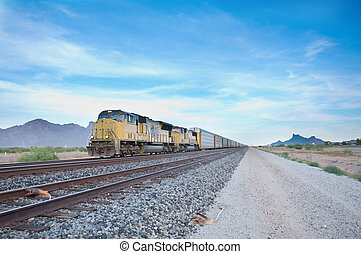 Railroad locomotive travelling across Arizona