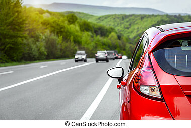 Car parked on the roadside. - Red car parked on the...