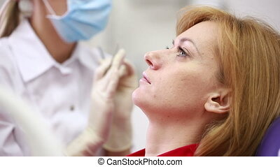 woman receiving dental inspection from dentist dental work