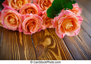 bouquet of pink roses on a wooden table