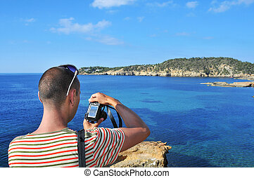 man taking a picture in Ibiza Island, Spain